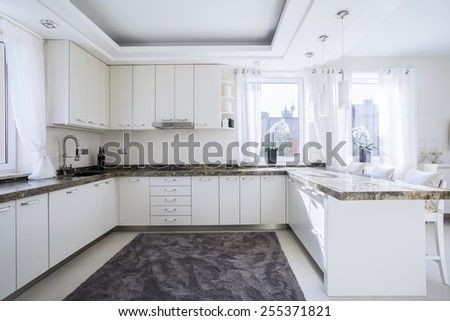 The bright, spacious and modern kitchen - stock photo