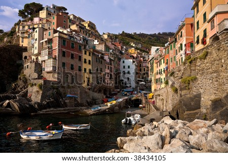 The brightly coloured houses of Riomaggiore, one of the five villages of the Cinque Terre, Liguria, Italy. - stock photo