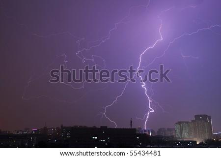 The brilliant lightning strike at night in summer - stock photo