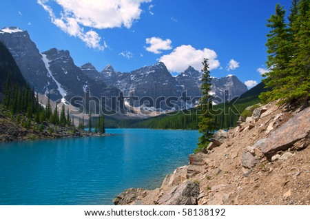 The brilliant turquoise waters of Moraine Lake, Alberta. - stock photo