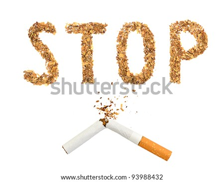 The broken cigaret and word stop made of tobacco isolated on white background - stock photo