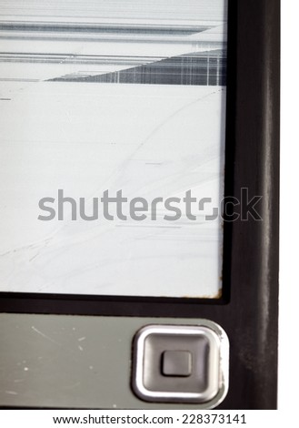 The broken electronic book with the rejected screen - stock photo