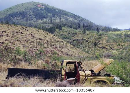 The broken truck in the mountainous landscape of Maui island, Hawaii. - stock photo