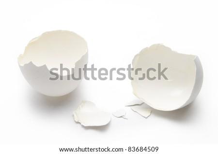 The broken white egg on the white background - stock photo