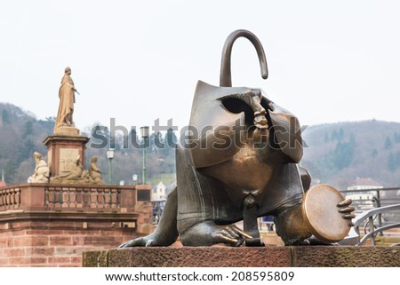The bronze monkey sculpture holds a mirror as Bridge mandrill at the west gate of old bridge in Heidelberg, Germany