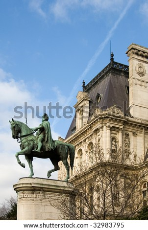 The bronze statue of Etienne Marcel proudly standing beside the Hotel de Ville, Paris, France