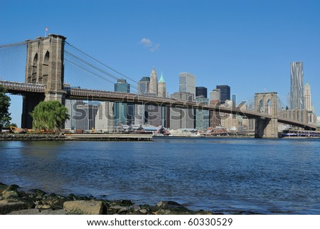 The Brooklyn Bridge and Downtown Manhattan in New York City. - stock photo