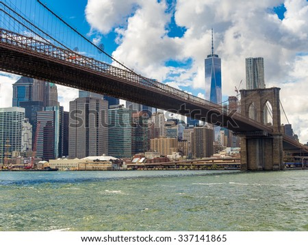 The Brooklyn Bridge and the downtown Manhattan skyline in New York City - stock photo