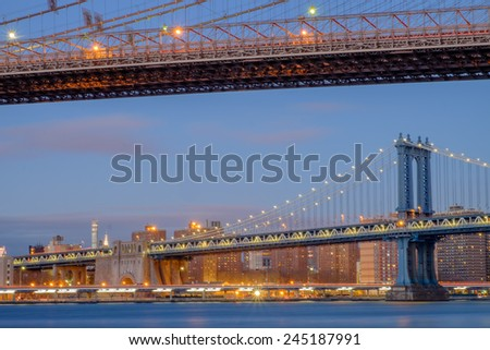 The Brooklyn Bridge and the Manhattan bridge spanning the East River from Brooklyn into Lower Manhattan and the financial district of New York City