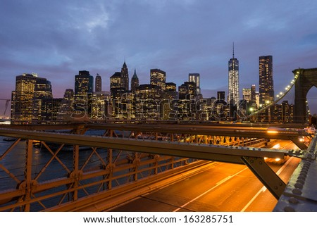 The Brooklyn bridge at dusk with downtown Manhattan, New York City. USA. - stock photo