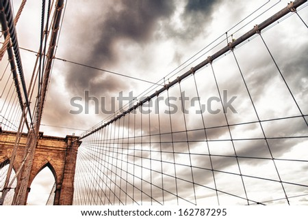 The Brooklyn Bridge. Close-up of Pylon and cables at summer sunset. - stock photo
