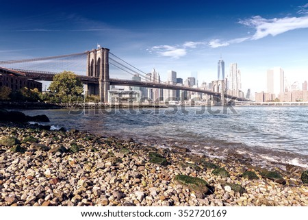 The Brooklyn Bridge on a sunny day. New York City, USA. - stock photo