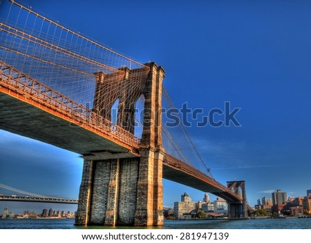 The Brooklyn Bridge over East River viewed from New York City in HDR