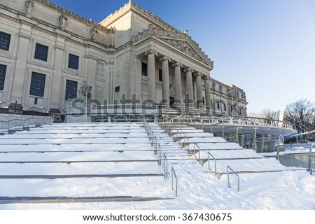 The Brooklyn Museum clad in ice and snow the morning after the Blizzard of 2016 in the Prospect Heights neighborhood of Brooklyn, New York. - stock photo
