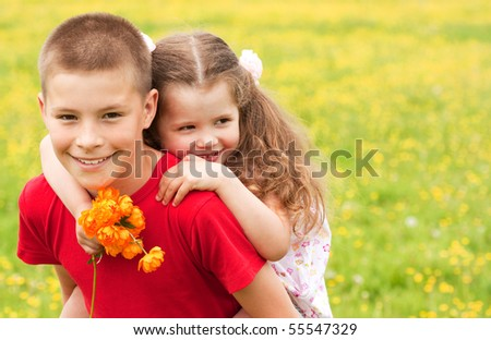 The brother with sister on the nature - stock photo