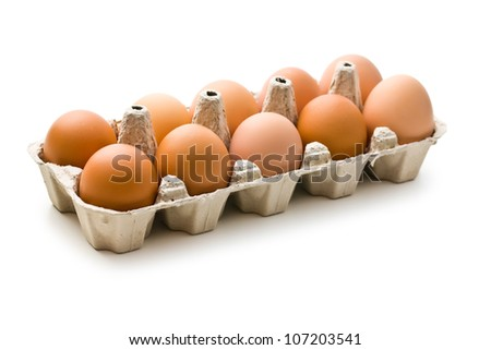 the brown eggs in egg box - stock photo