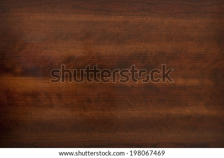 The brown, grainy appearance of a wooden surface. - stock photo