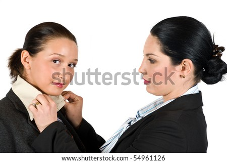 The brunette business woman arranges her colleague necktie and the shirt collar for an interview or meeting