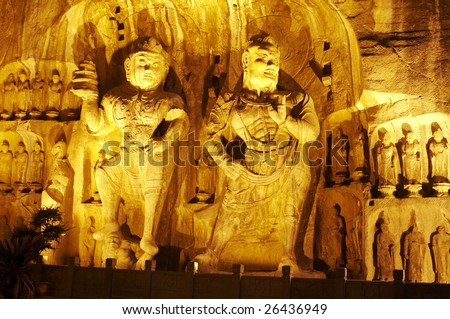 The buddha of Longmen Grottoes in the night, which were created in the Northern Wei and Tang Dynasty - stock photo