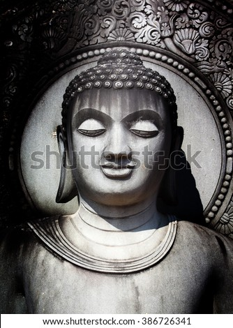 The Buddha statue from sandstone carving of Thailand.