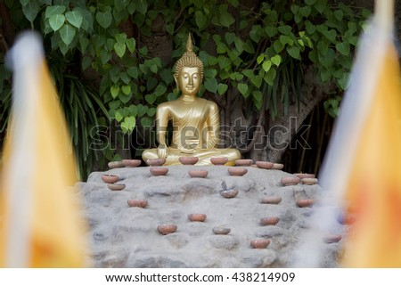 the Buddha with candles and in Phan Tao Temple, Chiangmai, Thailand - stock photo