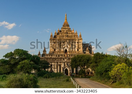 The buddhist Thatbyinnyu Temple in Myanmars famous Bagan Area was built until 1144 and has a height of 61 meters. - stock photo