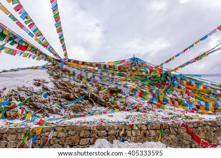 The Buddhist tibetan prayer flags on the top of Sejila mountain in Nyingchi, Tibet of China. - stock photo