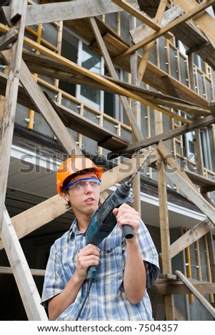 The builder hold manual drill in hands.