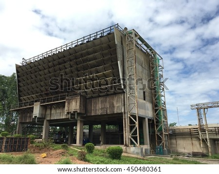 the building construction of cooling tower of power plant industry to heat transfer energy from water evaporation and air environment technology  - stock photo