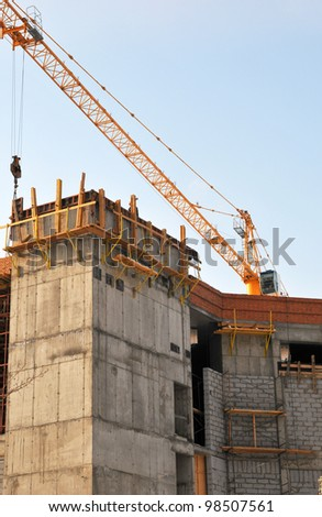 The building is constructed with the help of a crane