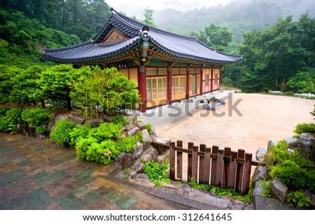 The building of Buddhist Sinheungsa Temple in Seoraksan National Park, South korea  - stock photo