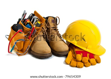 The building tools and protective means. Working boots, tools, building helmet, goggles and gloves - stock photo