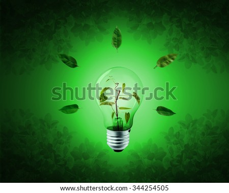 The bulbs are contained within the tree on a green background. Energy saving concept - stock photo