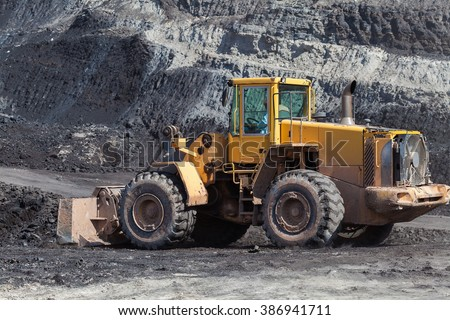 The bulldozer working In coal mines.