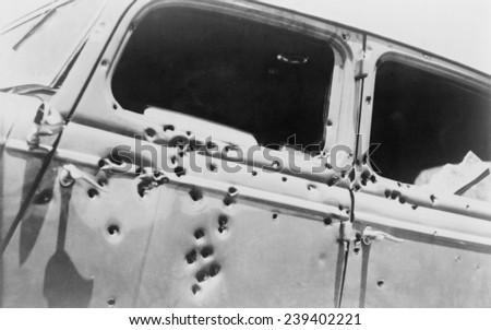 The bullet riddled car in which bank robbers Bonnie and Clyde died at the hands of Texas Rangers and Louisana police at Gibsland, Louisiana on May 23, 1934. - stock photo