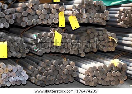 The bundle of rust steel rod in warehouse - stock photo