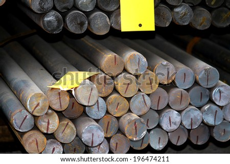 The bundle of rust steel rod in warehouse - stock photo