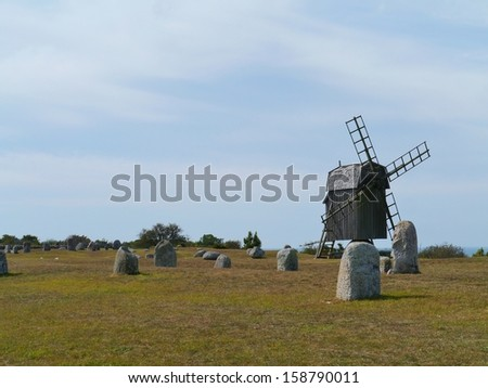 The burial ground of the village Gettlinge with  a wooden wind mill on the island Oeland in Sweden - stock photo