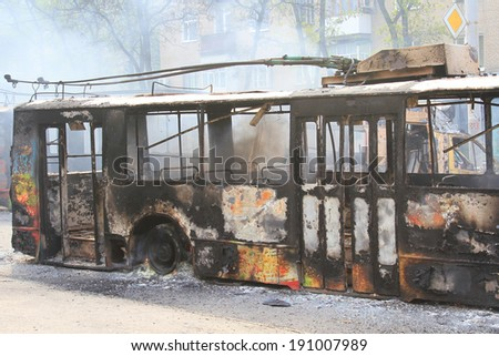 the burned-down public transport on a city road