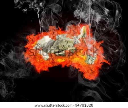The burning and smoking dollar on a black background. Financial crisis. The unsuccessful investment. The burnt down savings. - stock photo