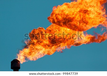 The burning of associated gas in the atmosphere - stock photo