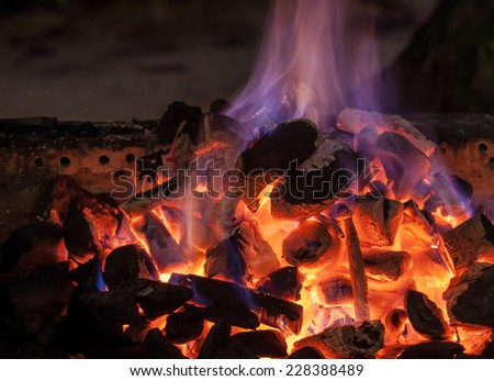 The burning of charcoal in a kiln - stock photo