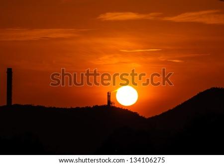 The burning sun of the chimney - stock photo