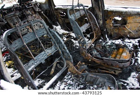 The burnt down car. The second day after a fire. - stock photo