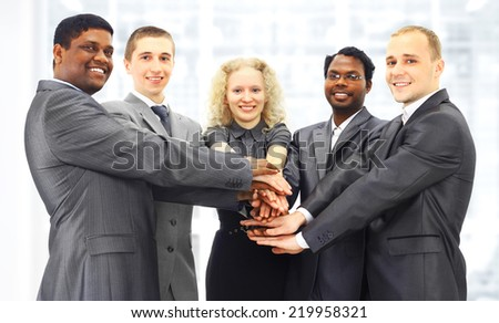 The business group in the office of the
