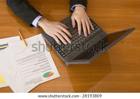 The business people planning on the laptop - stock photo