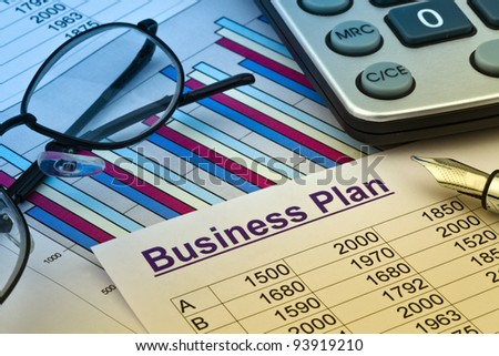 the business plan for a company or business establishment. planning a young entrepreneur. - stock photo