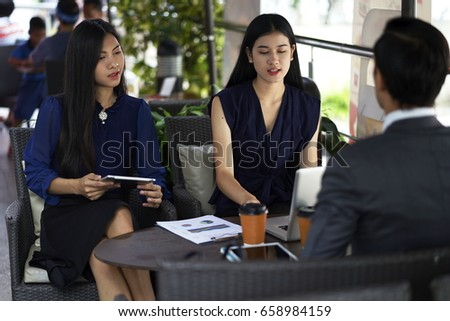 the business talking with partner at coffee shop