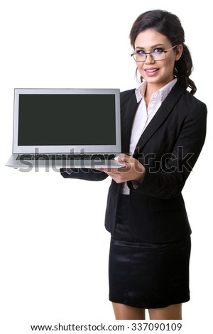 the business woman holds the laptop in hand - stock photo