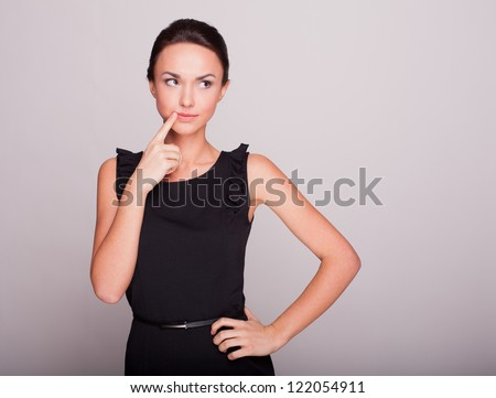 the business woman in a black dress reflected - stock photo